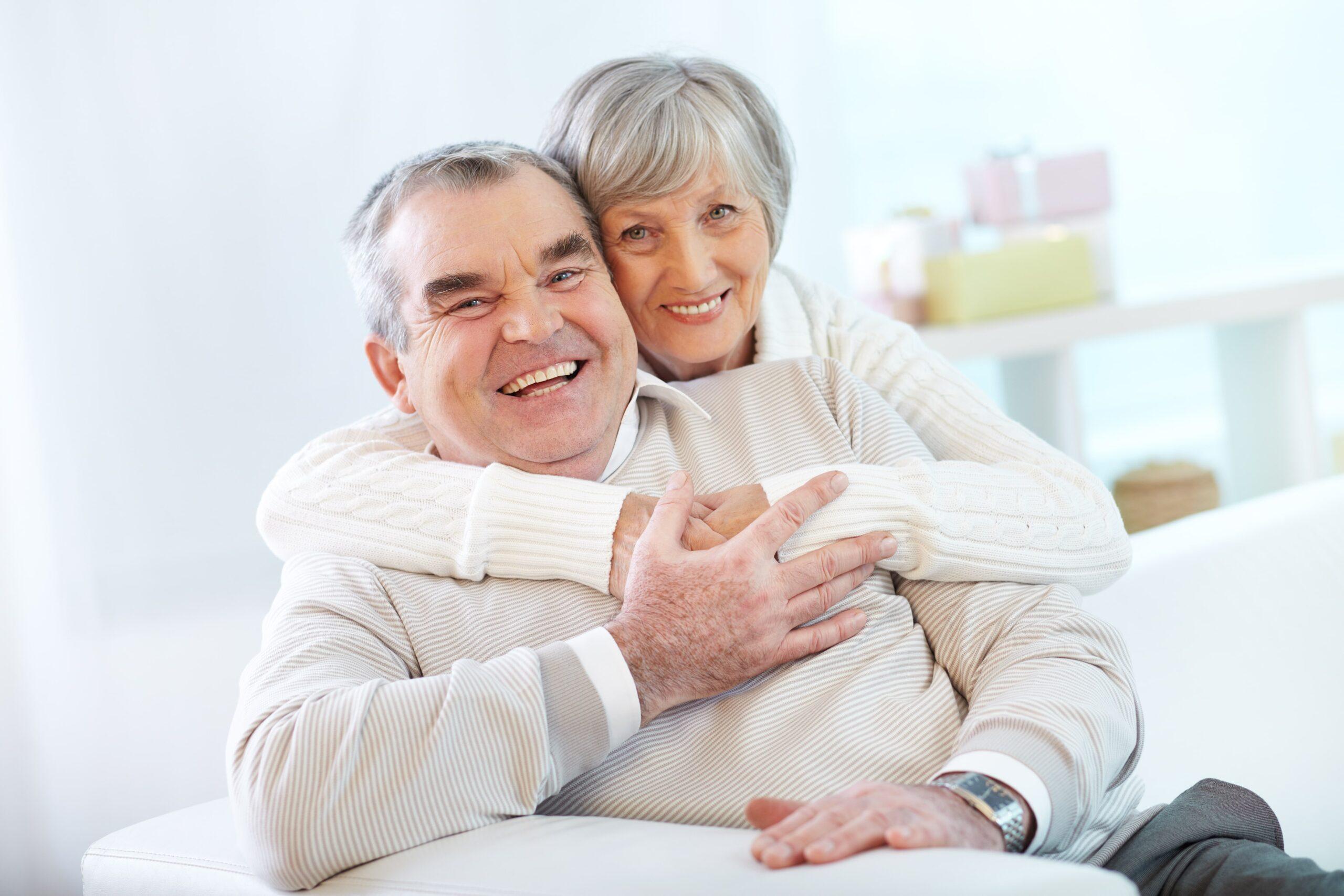 senior-couple-hugging-in-home