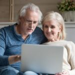 elderly-couple-checking-funeral-insurance-plans-for-parents-on-laptop