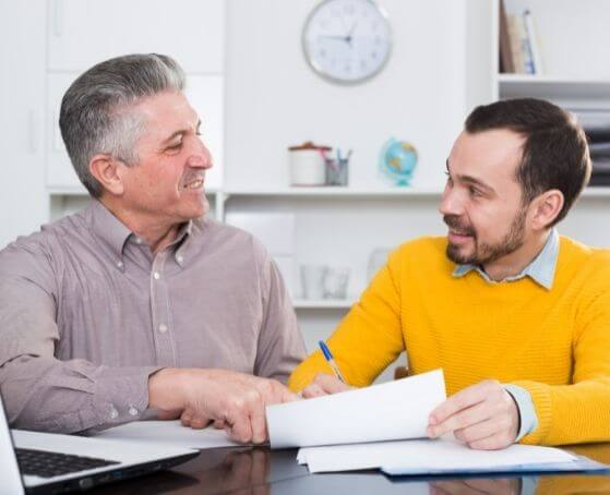 life-insurance-agent-shaking-hands-with-old-man