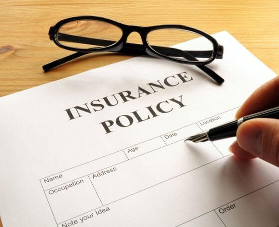 man-filling-AIG-Insurance-policy-form