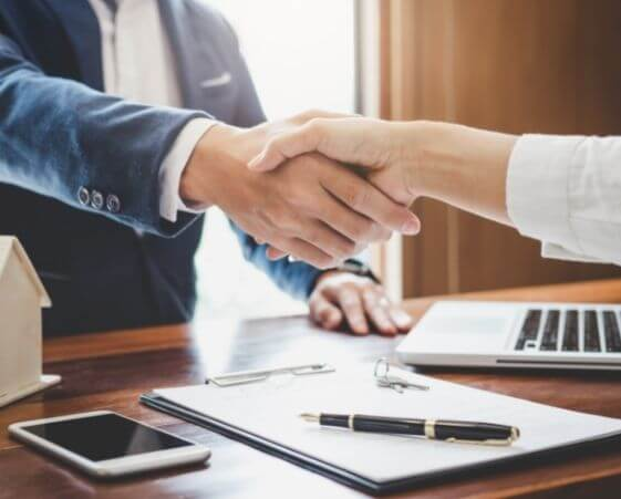 man-shaking-hands-with-insurance-agent-after-signing-life-insurance-plan