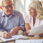 old-couple-signing-life-insurance-for-parents-over-70-policy