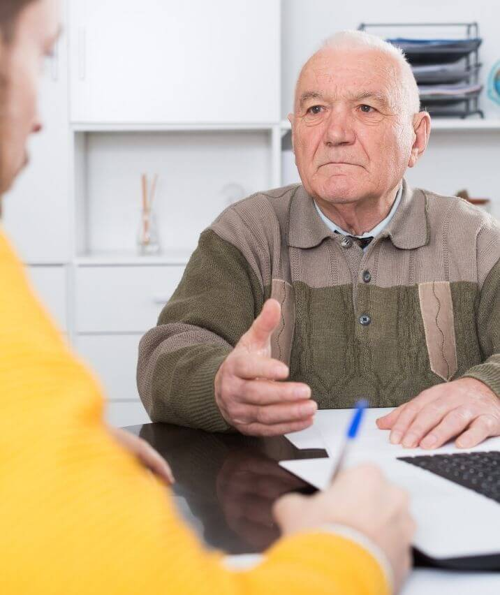 old-man-buying-life-insurance-from-Fidelity-insurance-company-agent