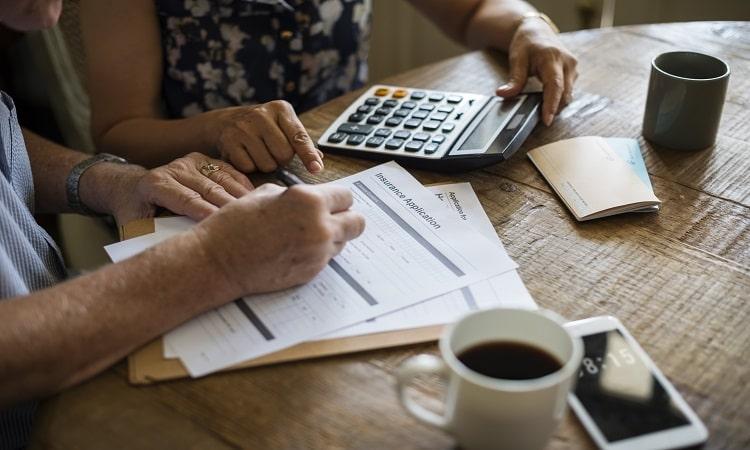 senior-couple-filling-term-life-insurance-application-form