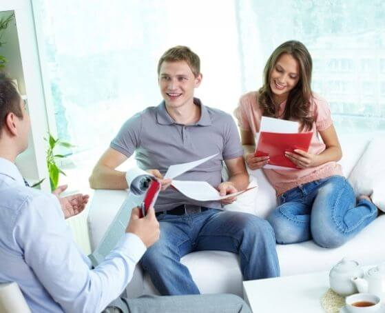 young-couple-discussing-life-insurance-with-GLOBE-life-insurance-agent