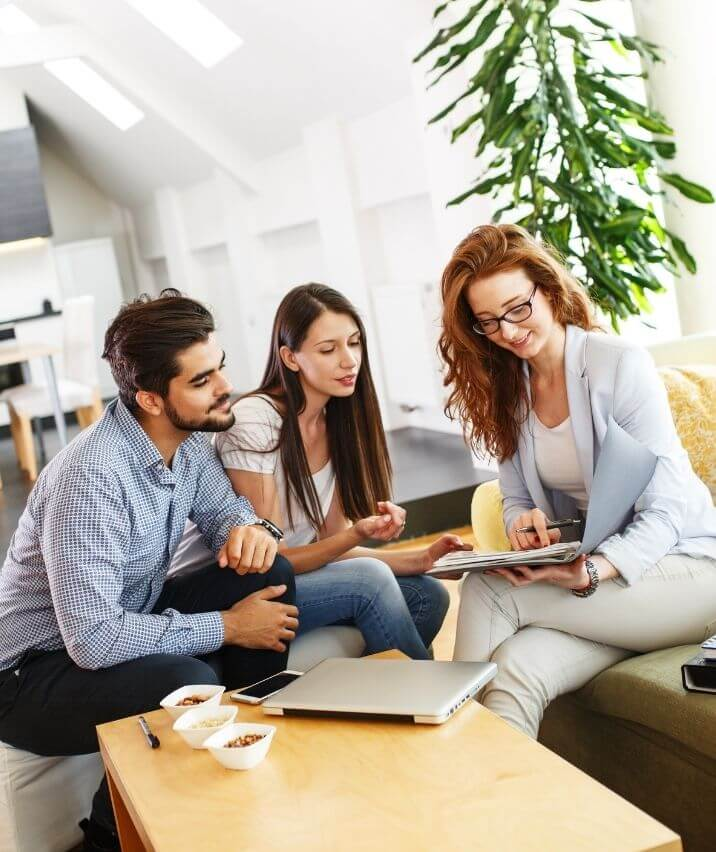 young-couple-sitting-with-METLIFE-Insurance-company-agent