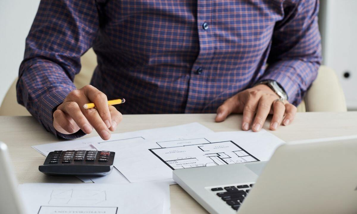 man-calculating-monthly-insurance-costs